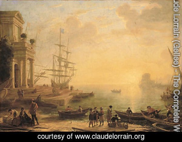 A capriccio of an Italianate harbour at sunset, with merchants, fishermen and stevedores on the shore in the foreground, men-o'-war at a quay beyond